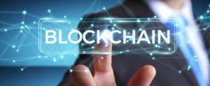 OBSIDIAM.COM-businessman-using-blockchain-cryptocurrency-interface-3d-rendering_117023-724