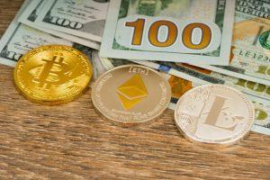 bitcoin-litecoin-ethereum-metallic-coins-dollars-banknote_190330-517