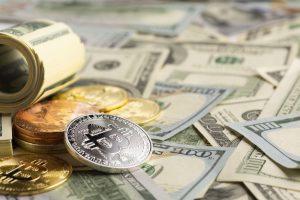 bitcoin-pile-top-dollar-bills_23-2148285288-obsidiam.com_