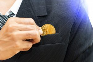 cryptocurrency-business-businessman-black-suite-holding-golden-coin-btc-clodeup-view-wit_24711-207-obsidiam.com_