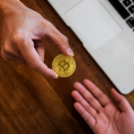hand exchange golden metal Bitcoin crypto currency investment- symbolic block chain financial internet and technology