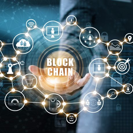Blockchain technology and network concept. Businessman holding text blockchain in hand with icon network connection on blue security  and digital connection background