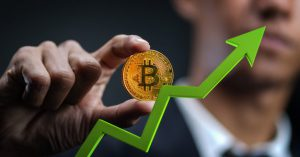 growth-bitcoin-businessman-holding-bitcoin-with-green-3d-arrow-up_1379-4527-obsidiam.com_