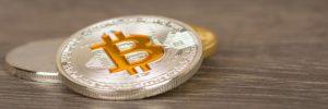 silver-metallic-bitcoin-coin-wooden-table_190330-315-obsidiam.com_